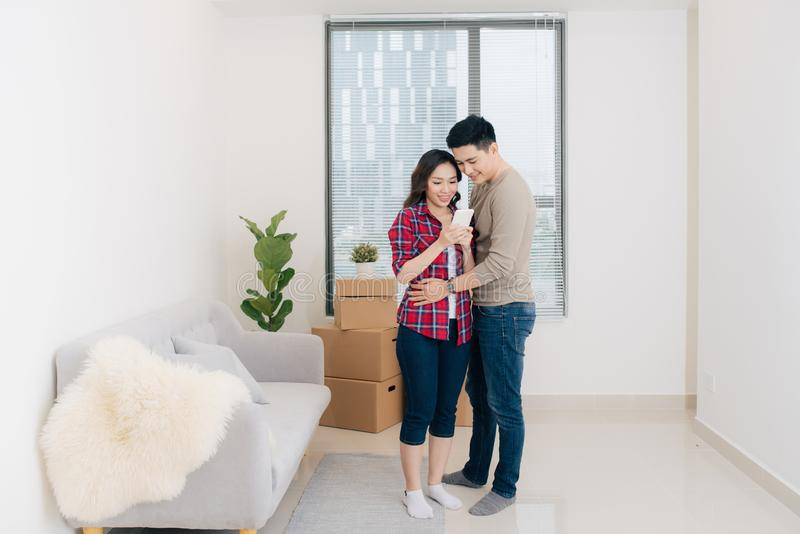 Young asian couple moving to a new apartment together relocation royalty free stock images