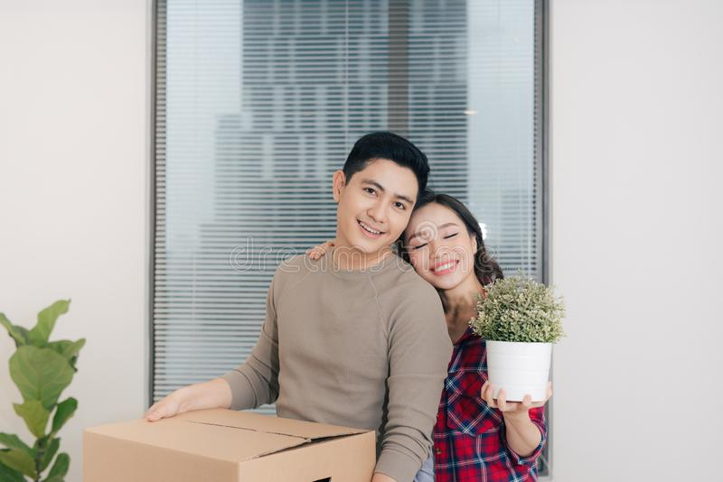 Young asian couple moving to a new apartment together relocation royalty free stock image