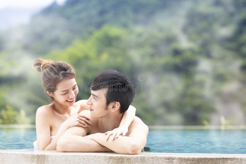 Young couple relaxing in hot springs. Young asian couple relaxing in hot springs stock image