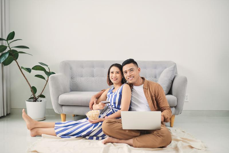 Young Asian couple shopping online at laptop computer at home. Image stock image