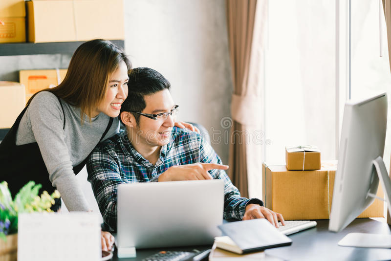 Young Asian couple startup family business, online marketing packaging and delivery scene. SME entrepreneur, business partner, or freelance work at home stock images
