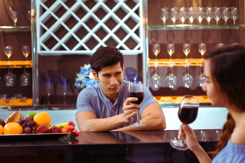 Young asian couple together man and woman clink glasses stock photo