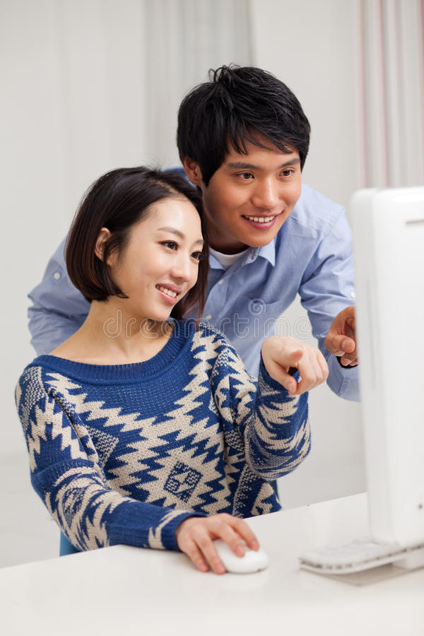 Download Young Asian Couple Using PC Stock Image - Image: 29040953