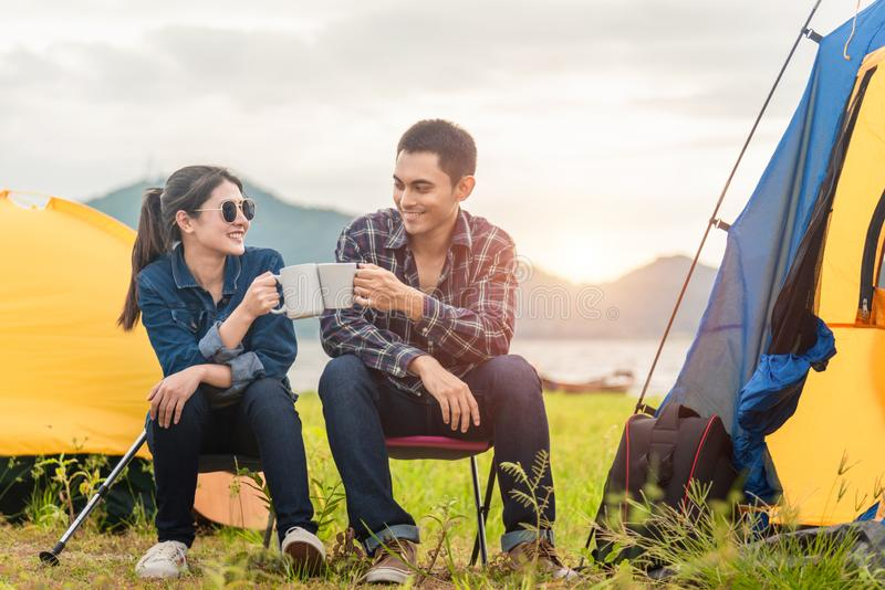 Young Asian couples are having fun together in the evening nature camping trip stock photos