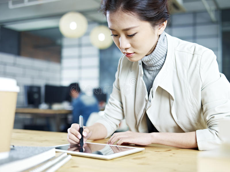 Young asian designer working in office stock image