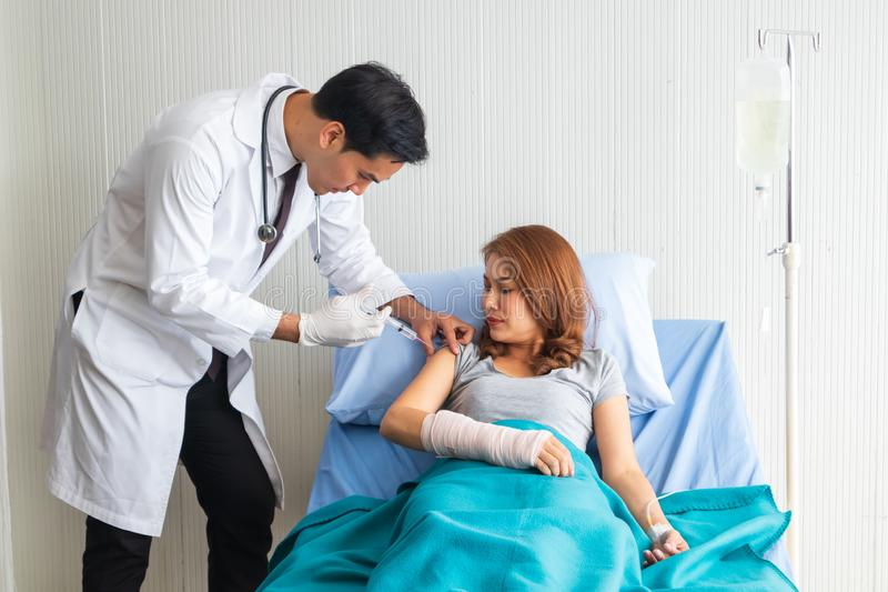 Young Asian doctor injecting medicine for the patient on the bed in the hospital stock photos
