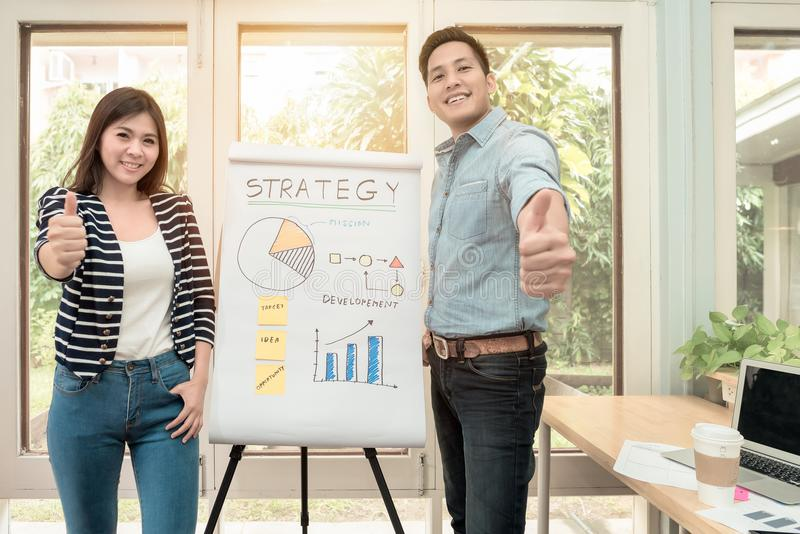 Young asian entrepreneur present business strategy concept. At home office.Conceptual for startup small businesses entrepreneur and freelance royalty free stock images