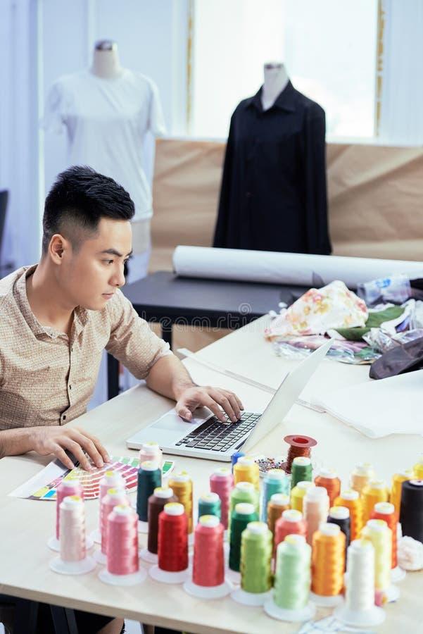 Fashion designer choosing color scheme stock images
