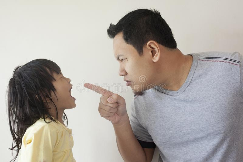 Faghter and Little Baby Daughter Arguing stock images