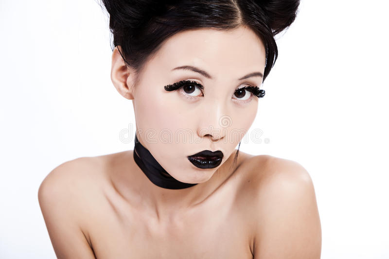 Young asian female with black makeup stock photography