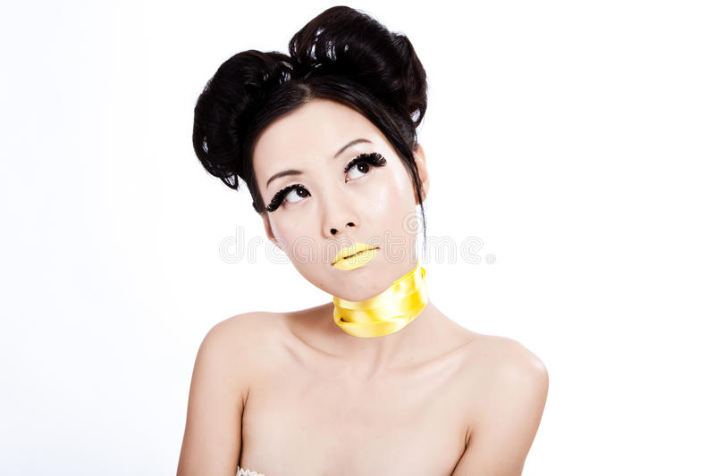 Young asian female with creative yellow makeup royalty free stock images