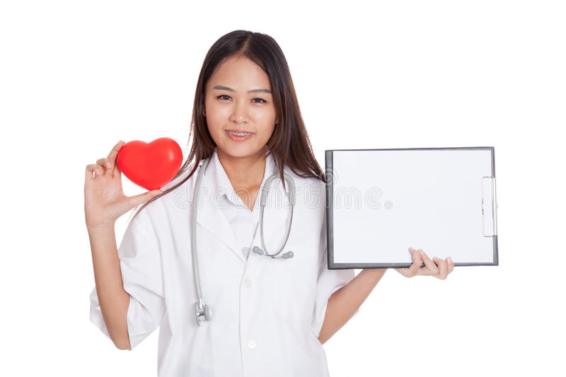 Young Asian female doctor with red heart and blank clipboard. Isolated on white background royalty free stock photography