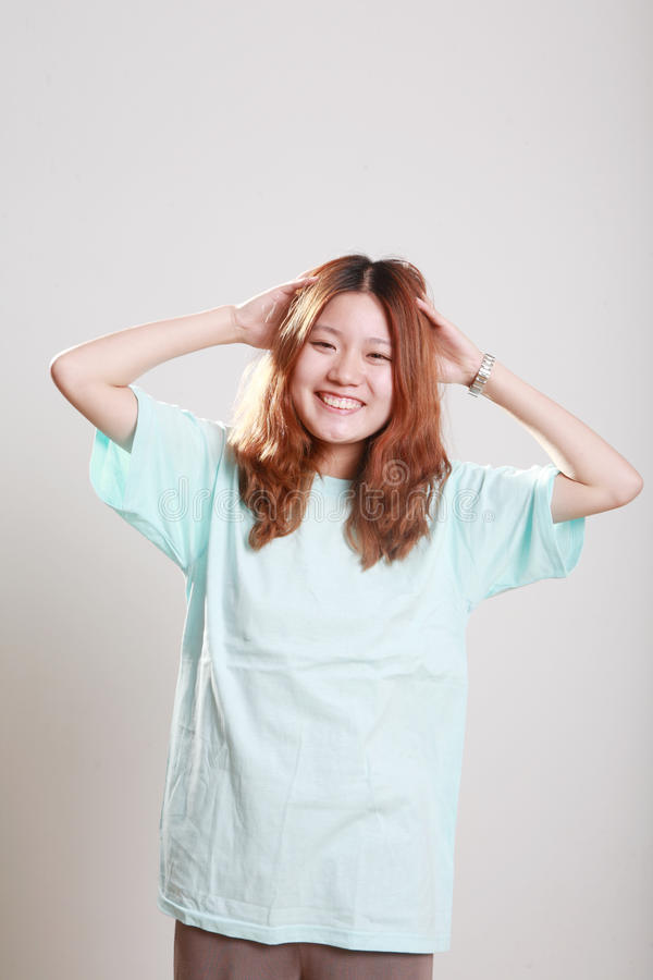 young, Asian female model in bright blue t stock photos