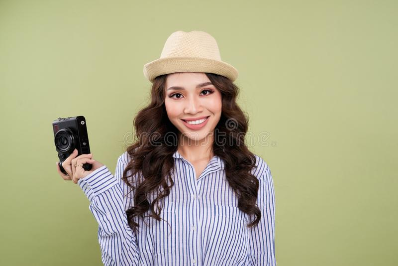 Young asian female traveler in casual clothing holding an amateur digital camera. stock photo
