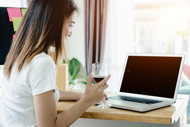 Young Asian girl is freelancer with her private business. At home office, working with laptop, coffee, online marketing, Customer order and packaging or packing royalty free stock photos