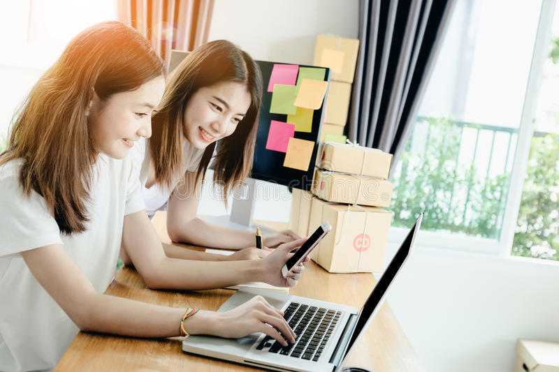 Young asian girl freelancer. Young asian girl is freelancer with her private business at home office, working with laptop, coffee, online marketing, Customer royalty free stock images