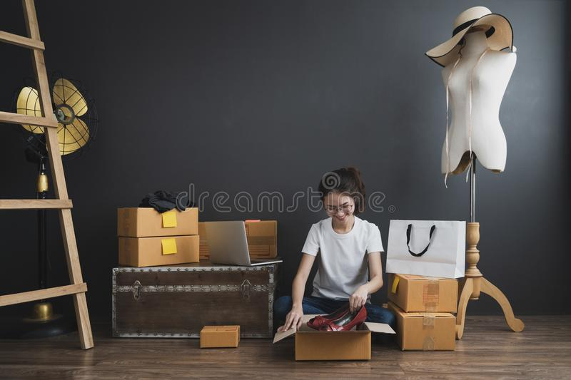 Young asian girl is freelancer with her private business at home office, Working with laptop, Coffee, Online marketing. Customer order and packaging or packing stock images