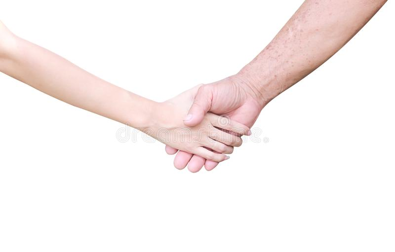 Young asian girl hand and elderly man shaking hands close up isolated on white background with clipping path. Close up Young asian girl hand and elderly man stock image
