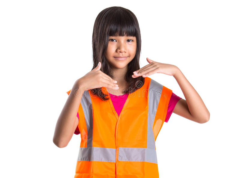 Young Asian Girl With Safety Vest III. Young Asian preteen girl with an orange safety reflective vest over white background royalty free stock photos