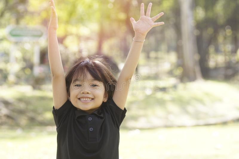 Young asian girl show hand in happy face and smile stock image