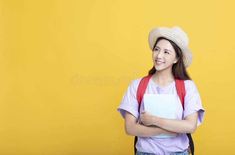 asian girl  student holding the  book  and looking royalty free stock photography