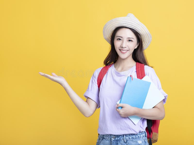 Young  girl  student holding book and showing royalty free stock images
