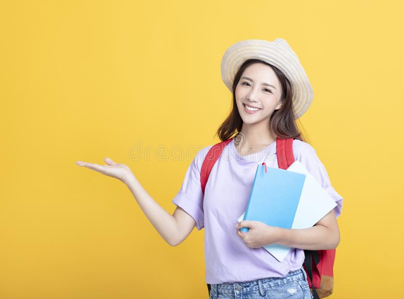 asian girl  student holding book and showing royalty free stock photo