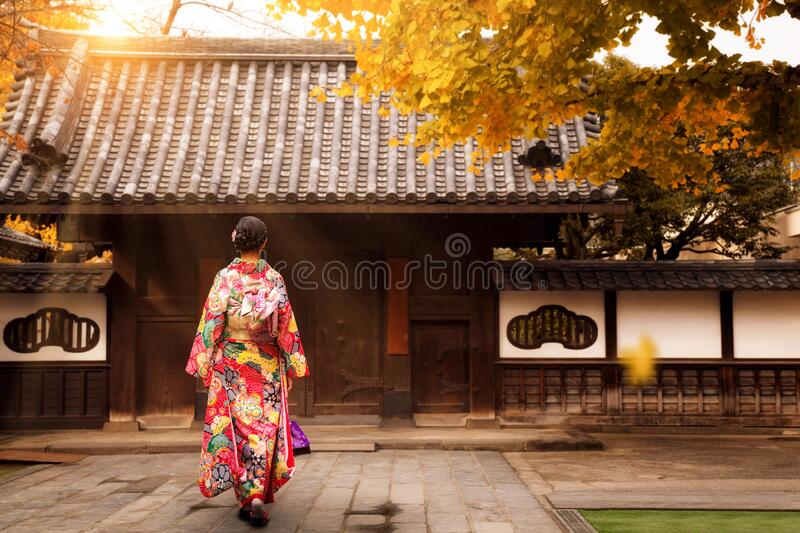 Young asian girl walking and wearing kimono stock photography