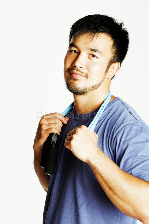 Young asian guy with skipping rope on white background ready to. Training sport, lifestyle people concept in studio stock images