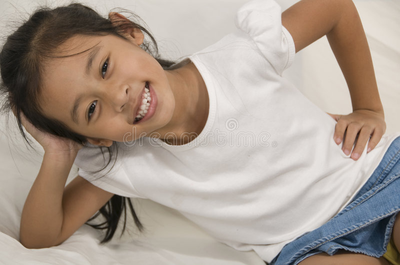 Young Asian happy little girl royalty free stock photography