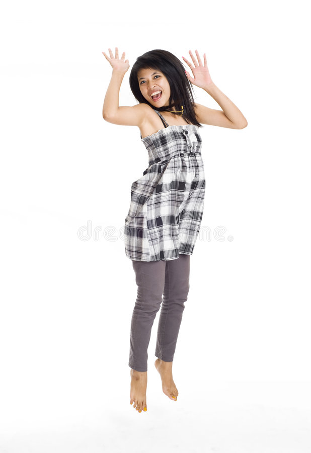 Young asian jumping for joy