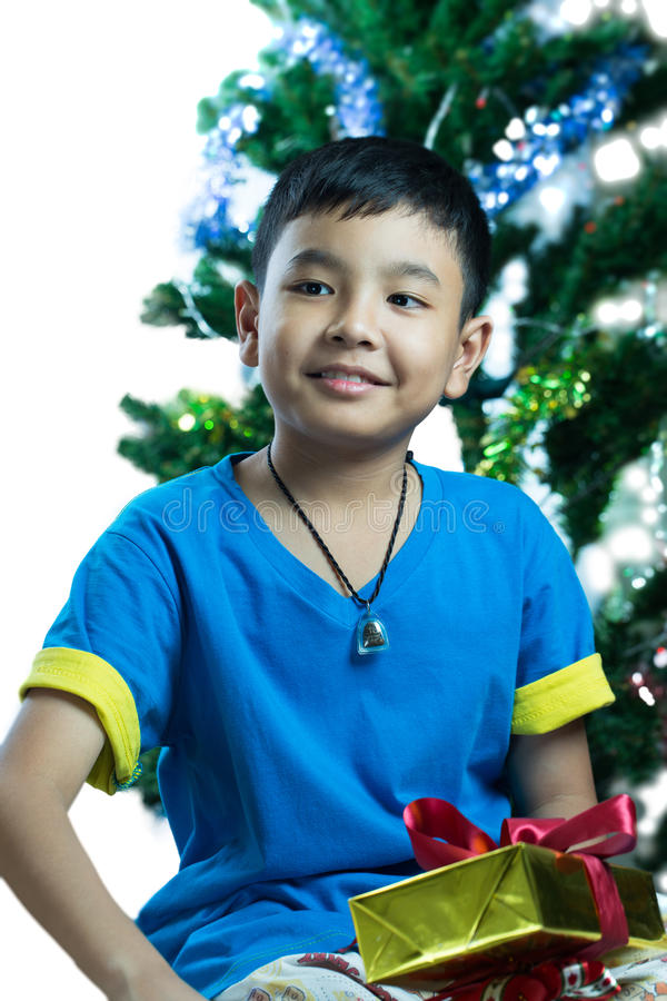 Young asian kid get his Christmas gift stock photography