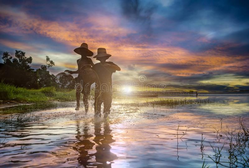 Young asian kids fisherman run and casting freshwater stock images