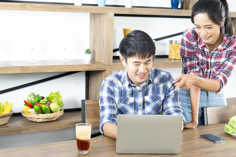 Young Asian lovely couple drinking coffee with milk stock images