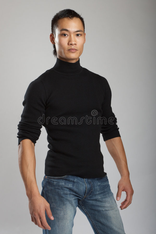 Young asian male model. Great looking asian male model shot in studio stock photo