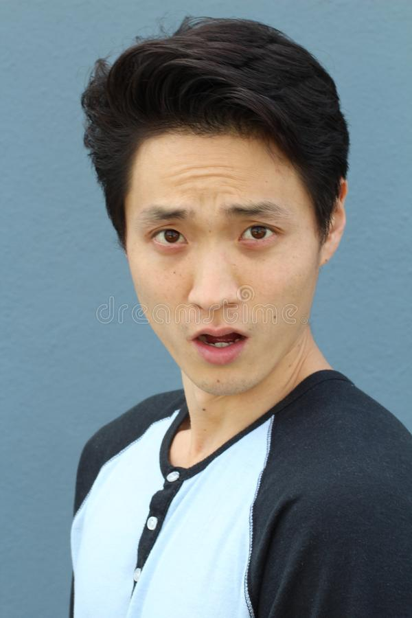 Young Asian male with shocked expression stock images