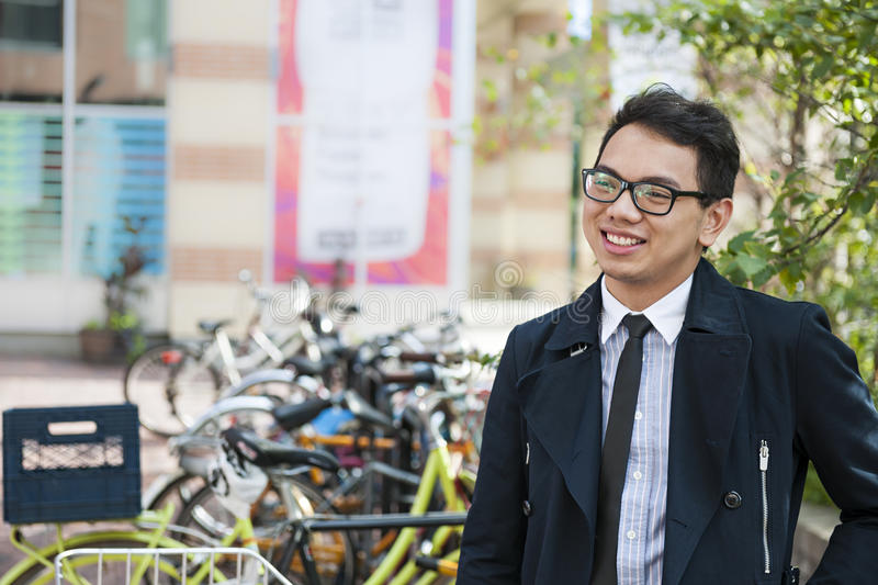 Young asian man with bicycle royalty free stock images