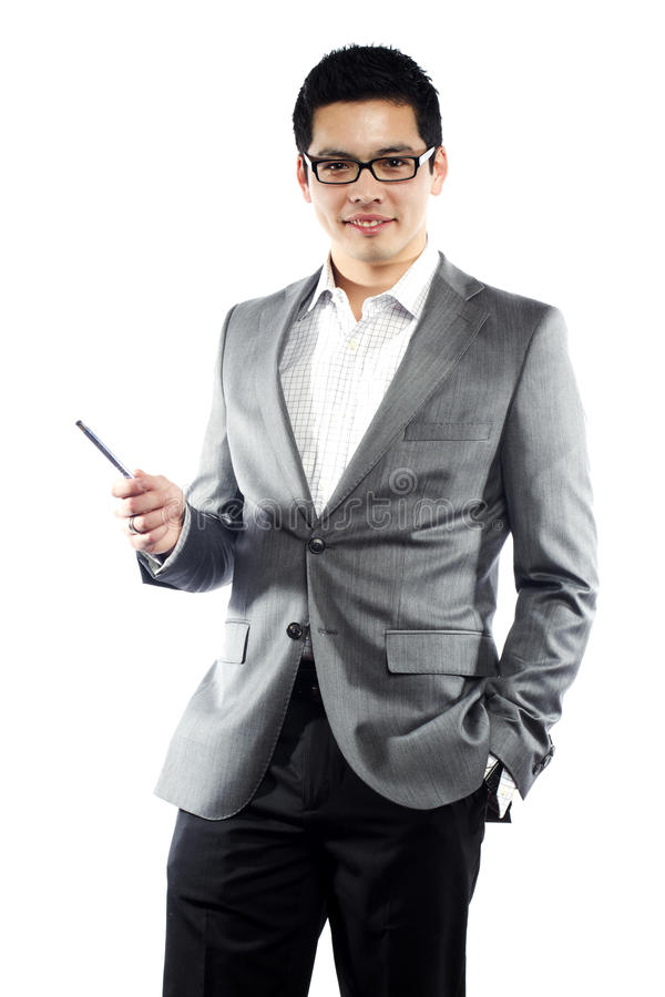 Download Young Asian Man In Business Attire Holding Pen Stock Photo - Image of asian, blazer: 20703154
