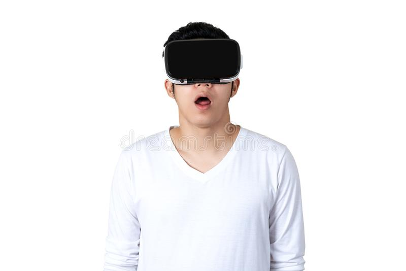 Young asian man in casual white outfit holding or wearing VR glasses watching video stock photo