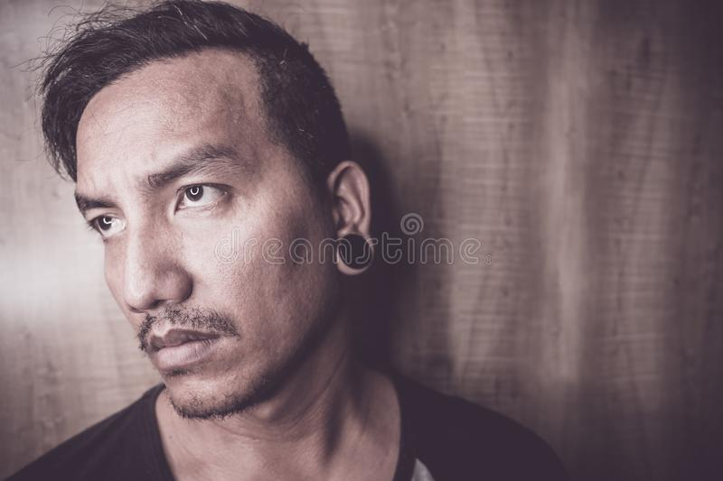 Young Asian man are depressed and alone royalty free stock photo