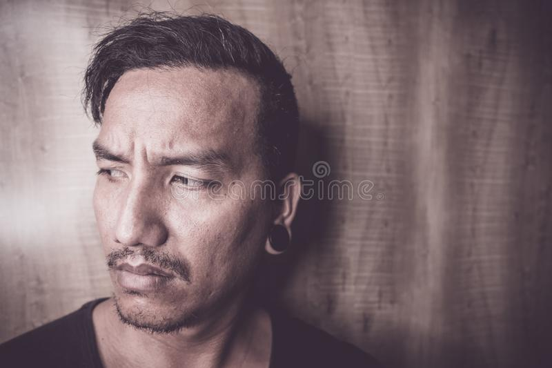 Young Asian man are depressed and alone royalty free stock photos