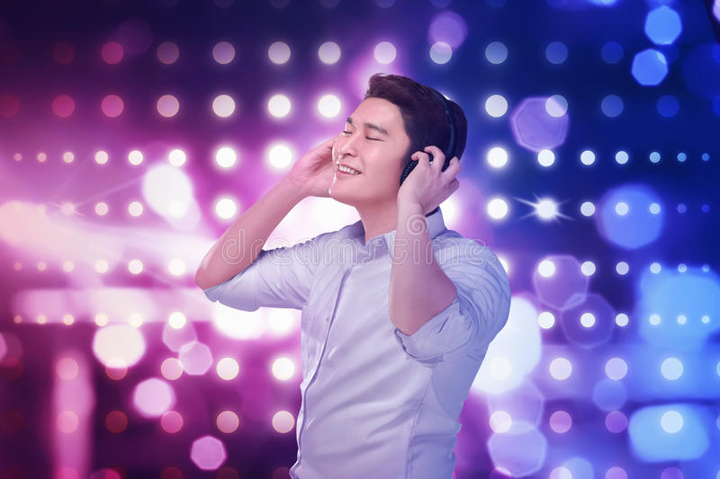 Young asian man listening music headphones with relax royalty free stock image