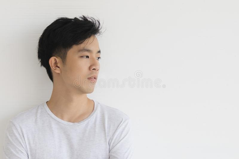 Young Asian man model in T-shirt crossed arm royalty free stock images