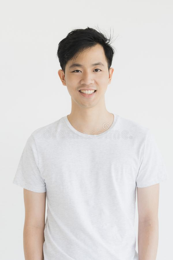 Young Asian man model in T-shirt crossed arm stock photo