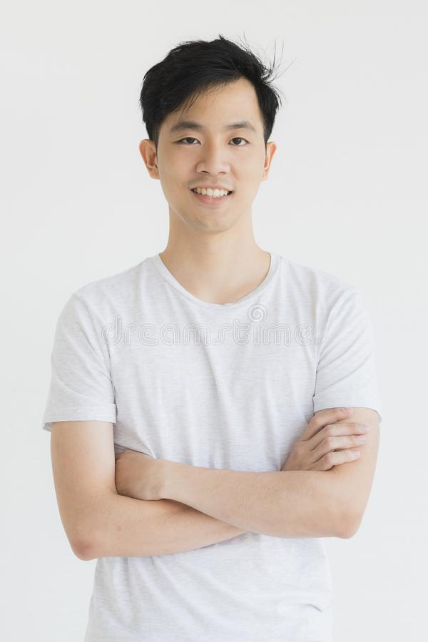 Young Asian man model in T-shirt crossed arm royalty free stock image