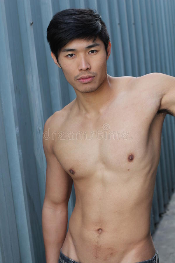 Young Asian man with muscular torso stock image