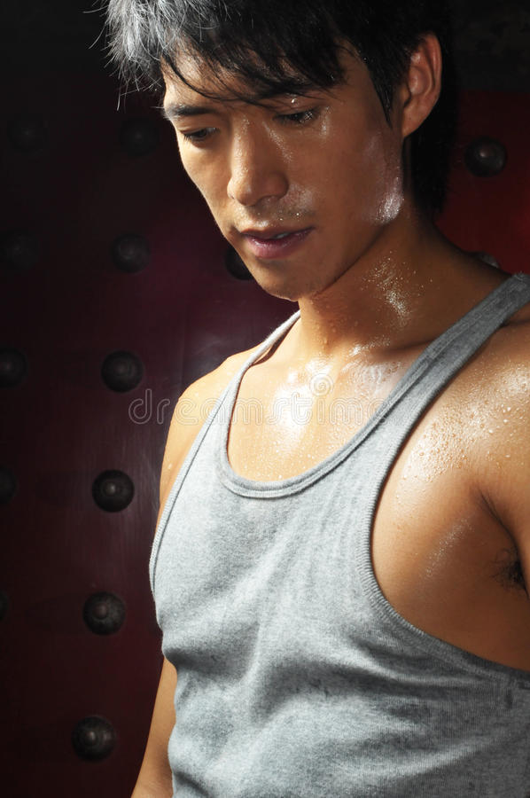 Young Asian Man Perspiring and look disappointed stock photography