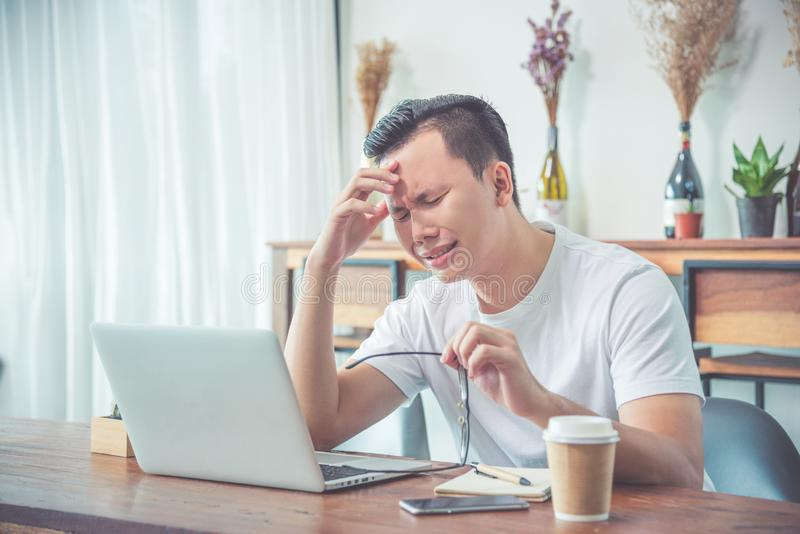 Man sitting on chair and crying because his work is fail stock photography