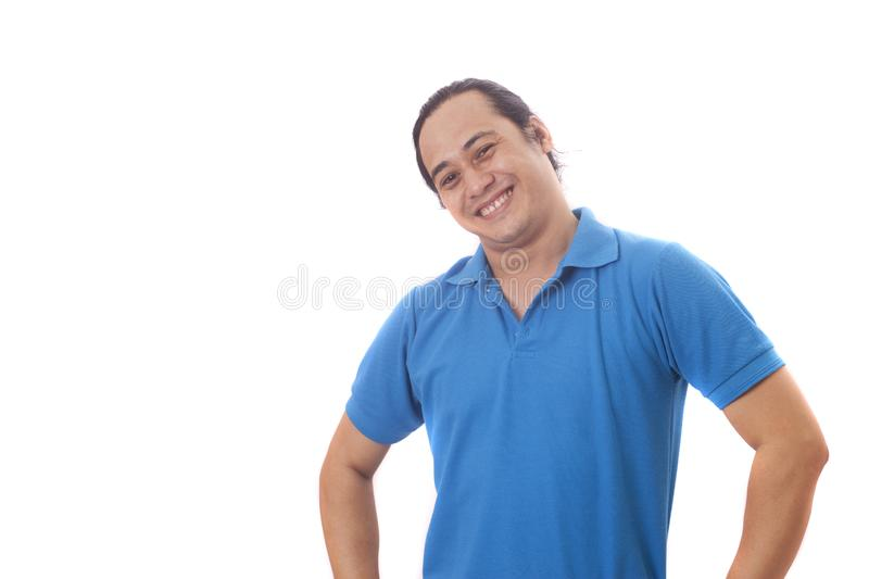 Young Asian Man Smiling, Happy Expression. Young Asian man wearing blue shirt smiling and laughing happily expression.  Isolated on white human one single royalty free stock photos