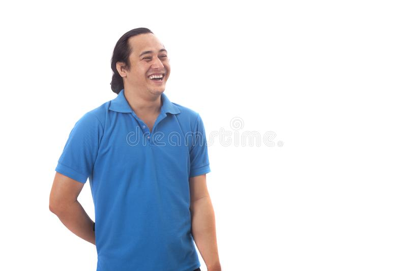 Young Asian Man Smiling, Happy Expression. Young Asian man wearing blue shirt smiling and laughing happily expression.  Isolated on white human one single stock photography